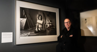 Aubrey Powell in the Browse Gallery exhibition Daring to Dream. 50 Years of Hipgnosis, in front of a cult photo by Aubrey Powell/ Hipgnosis of Syd Barrett in Yoga position. Photo: John G. Moore.